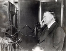 Photo of Herbert Hoover using television.